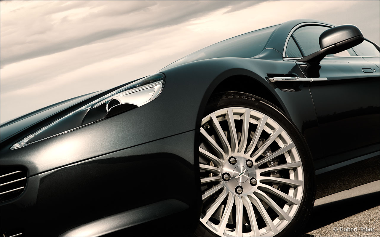 aston-martin-rapide-v12-luxus-sportwagen-alu-felge-foto-by-robert-tober